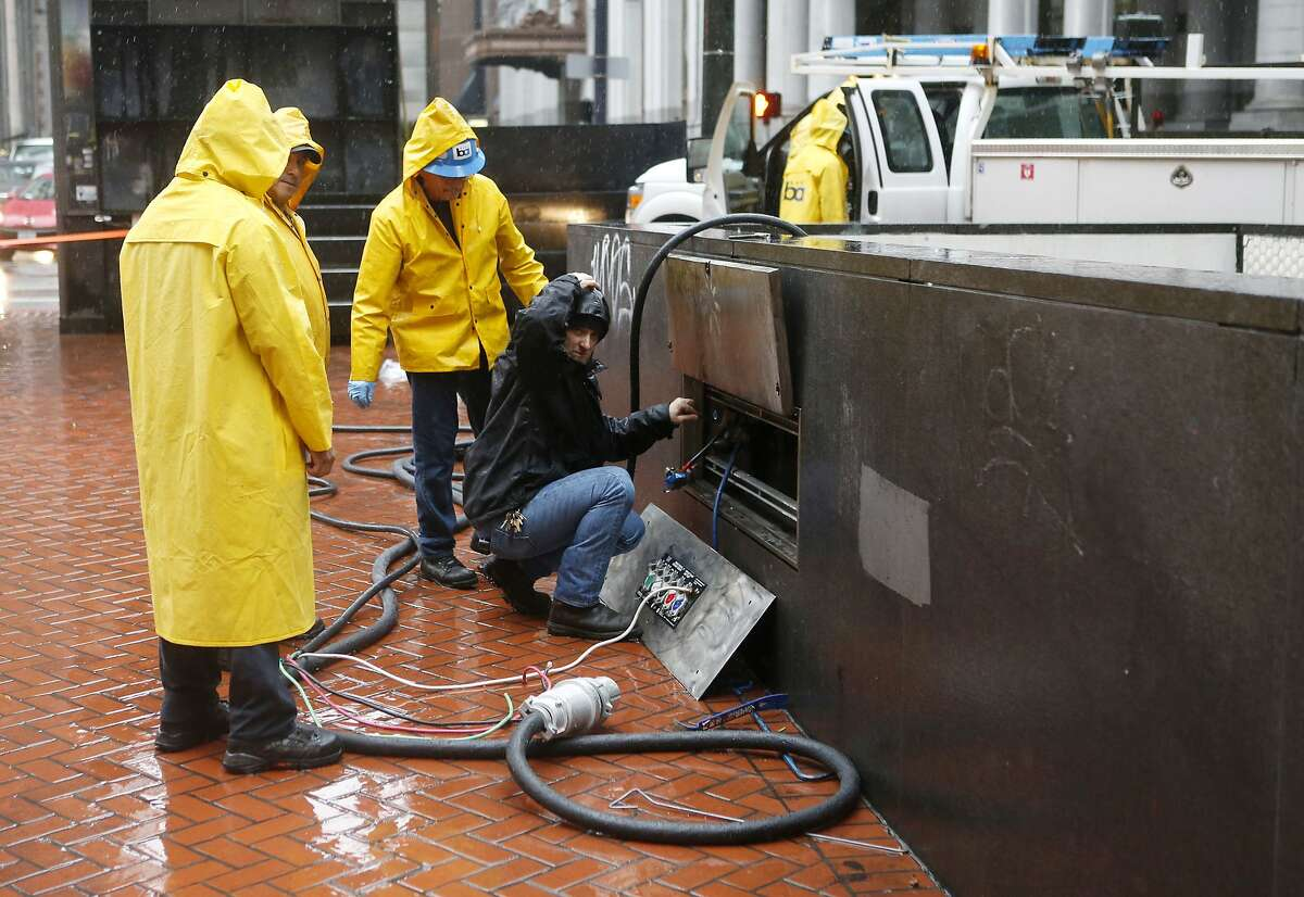 BART workers service an electrical panel outside the closed Montgomery BART and Muni station on Thursday, December 11, 2014 in San Francisco, Calif.