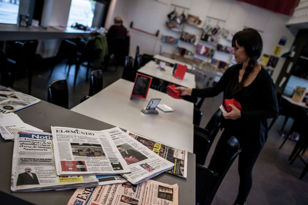 Spanish newspapers are stacked on a bar in Pamplona. Google said it will close its News site in Spain, and remove Spanish content from News globally.