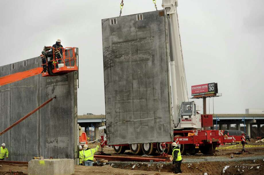 Prefabricated concrete walls are lifted into position during the start of vertical construction on the new Bass Pro Shops on Steel Point in Bridgeport, Conn. on Thursday, December 11, 2014. Photo: Brian A. Pounds / Connecticut Post