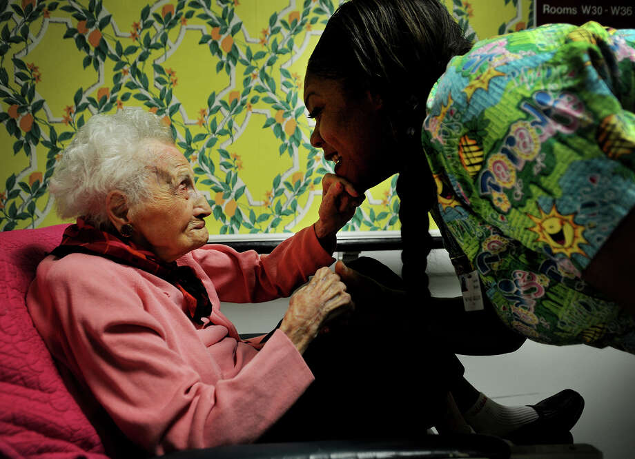Emily Tremonti, who just turned 110 years old, interacts with nurses aid Sunae Gilliam at The Carolton convalescent hospital in Fairfield, Conn. on Thursday, December 11, 2014 where she has resided since 2009. Tremonti is believed to be the oldest living person in Connecticut. Photo: Brian A. Pounds / Connecticut Post