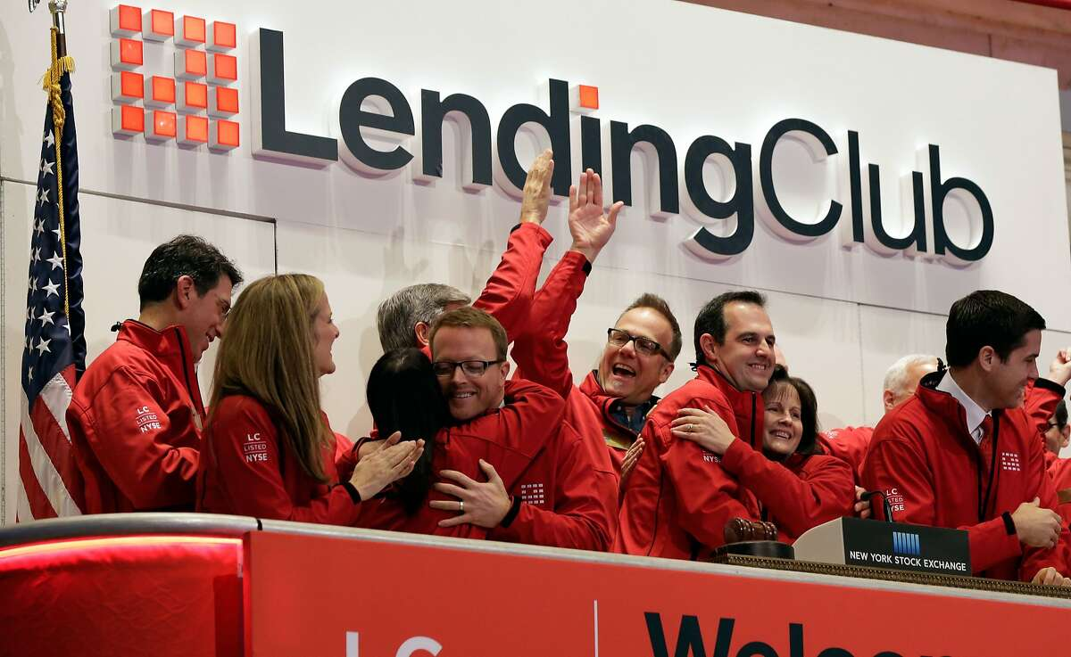 Renaud Laplanche, third from right, Founder & CEO of Lending Club, embraces company CFO Carrie Dolan during opening bell ceremonies of the New York Stock Exchange, to mark Lending Club's IPO, Thursday, Dec. 11, 2014. (AP Photo/Richard Drew)
