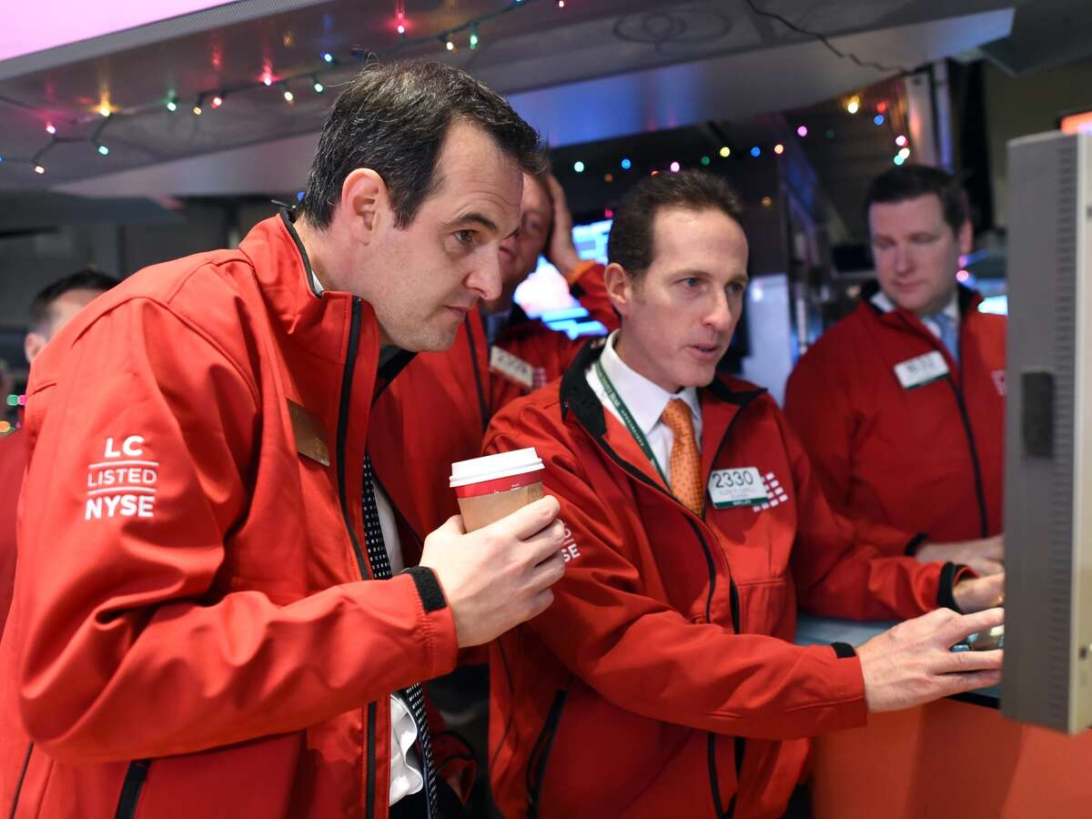 Lending Club Founder and CEO Renaud Laplanche (left) watches prices on the floor of the NYSE.