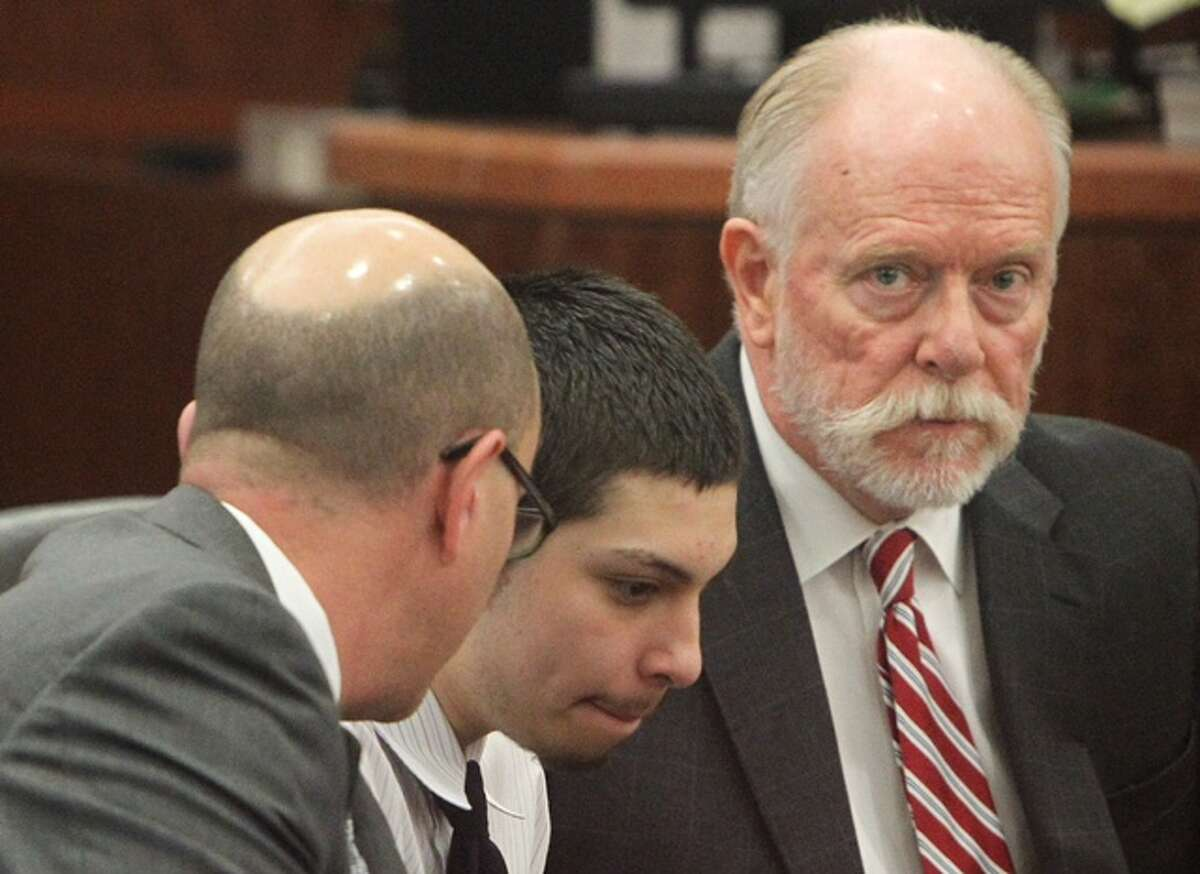 Defense attorney Jerald Graber, left and Jose Reyes, center, are seen at the 338th State District Court at the Harris County Criminal Courthouse after jurors announced Reyes guilty of capital murder in the killing of Corriann Cervantes.