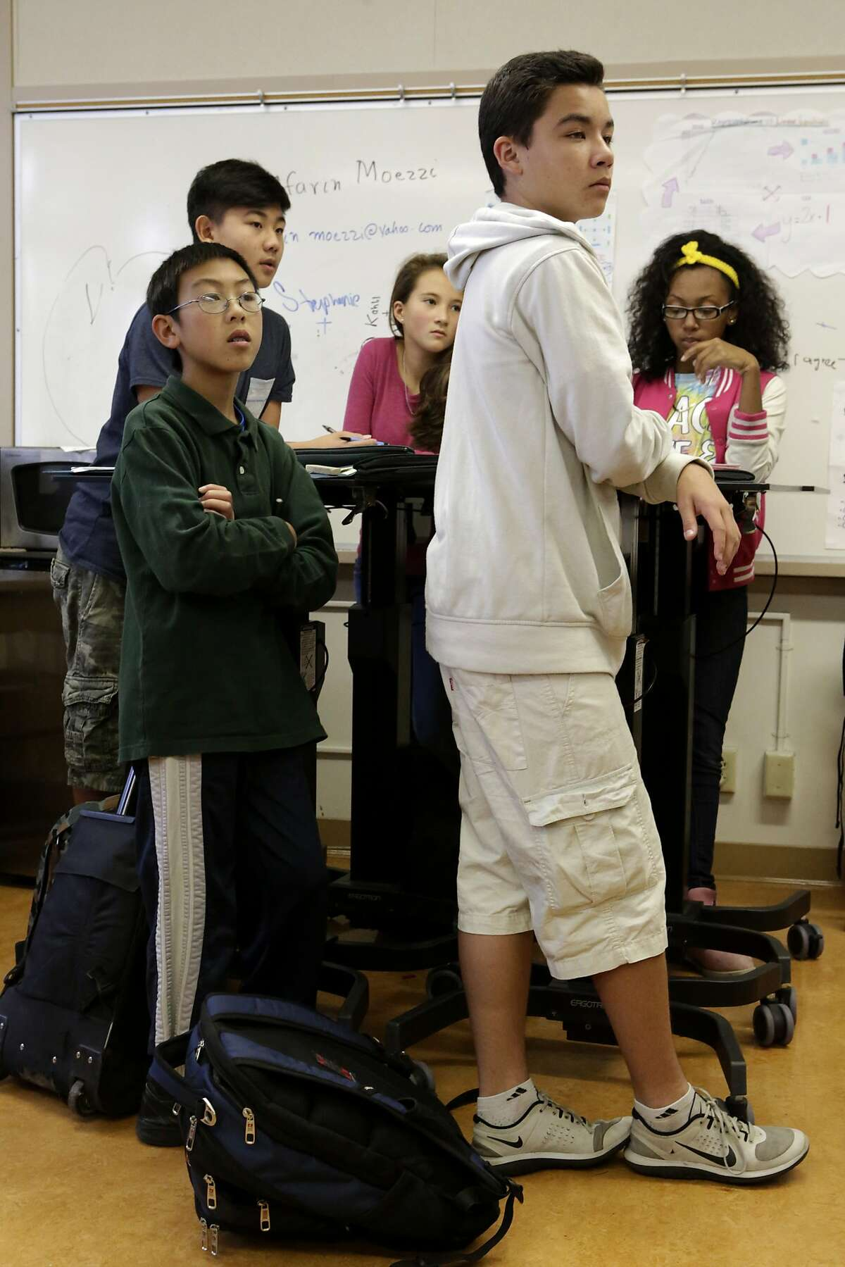 Eighth grade students stand at their desks during a math class at Montera Middle School in Oakland on Friday, November 14, 2014.