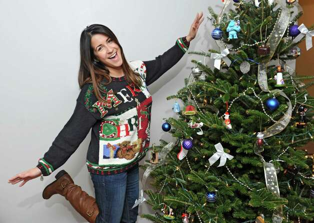 Jillian Diaz Cringle dons her Christmas sweater at her home on Friday, Dec. 5, 2014 in Latham, N.Y. (Lori Van Buren / Times Union) Photo: Lori Van Buren / 00029748A