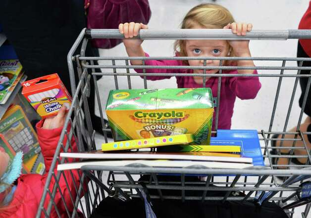 Three-year-old Abby Fazziola shops with her family at Wal-mart in Crossgates Commons for art supplies to be delivered to charities on Christmas Eve day as part of the Morning of Kindness program  Thursday Dec. 4, 2014, in Albany, NY.  (John Carl D'Annibale / Times Union) Photo: John Carl D'Annibale / 00029737A