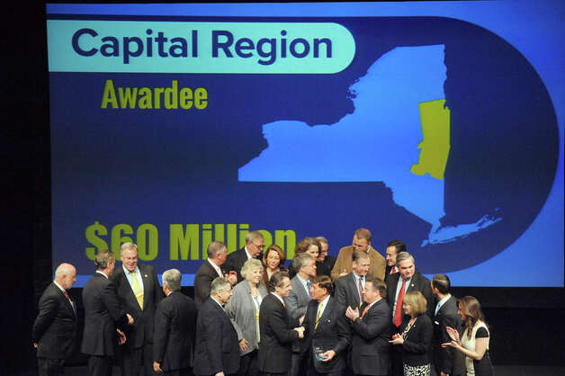 Capital Region public officials pose with Gov. Andrew Cuomo after receiving a $60 million Regional Economic Development Award at the Egg on Thursday Dec. 11, 2014 in Albany, N.Y.  (Michael P. Farrell/Times Union) Photo: Michael P. Farrell, Albany Times Union / 00029800A