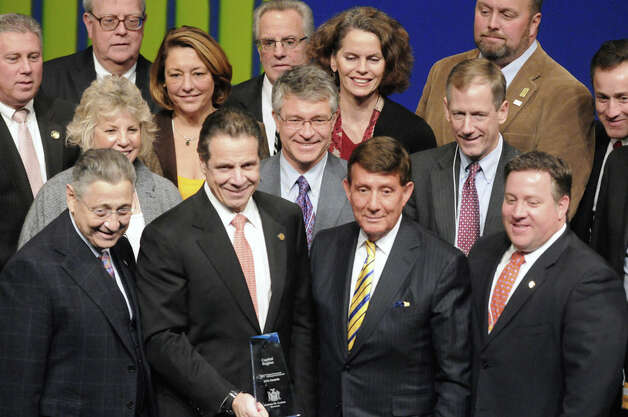 Capital Region public officials pose with Govorner Andrew Cuomo after receiving a $60 million dollor Regional Economic Development Award at the Egg on Thursday Dec. 11, 2014 in Albany, N.Y.  (Michael P. Farrell/Times Union) Photo: Michael P. Farrell, Albany Times Union / 00029800A