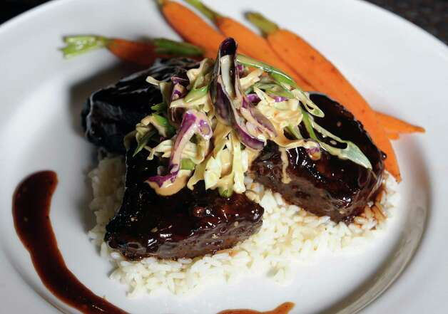 Korean style boneless short ribs at Charter restaurant at Hilton on Tuesday Dec. 9, 2014 in Albany, N.Y.  (Michael P. Farrell/Times Union) Photo: Michael P. Farrell / 00029692A