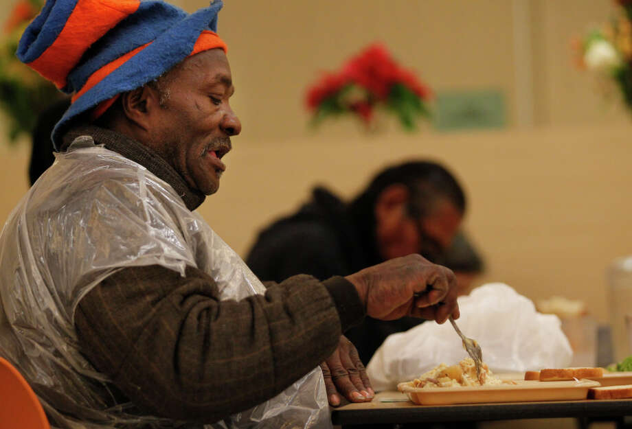 DeWayne Mabron, 58, eats lunch during meal service at St. Anthony's Dining Room in San Francisco on Thursday. Though GLIDE Memorial Church's dining room ran out of power, St. Anthony's continued to run with a generator as backup. Photo: Leah Millis / The Chronicle / ONLINE_YES