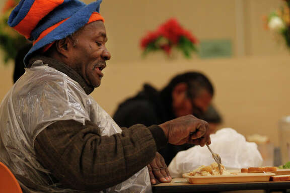 DeWayne Mabron, 58, eats lunch during meal service at St. Anthony's Dining Room in San Francisco on Thursday. Though GLIDE Memorial Church's dining room ran out of power, St. Anthony's continued to run with a generator as backup.