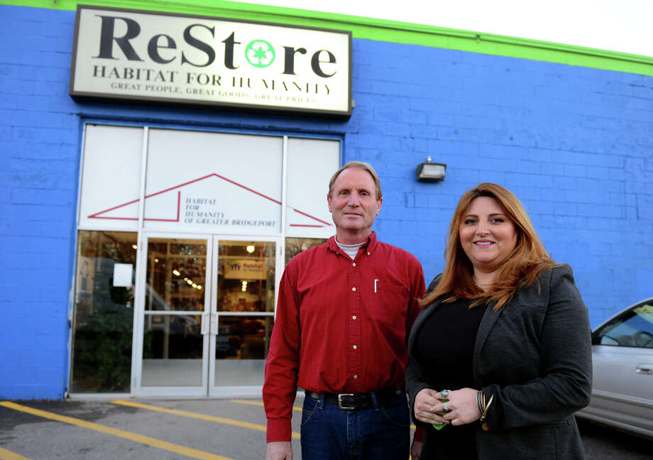 Habitat for Humanity ReStore Procurement Manager Lana Moore, right, poses with Hobbs Inc. supervisor Dave Skelton in front of the store in Stratford, Conn., on Thursday Dec. 11, 2014. Habitat for Humanity ReStore accepts furniture through many residential contractors and donations by homeowners who may be upgrading or remodeling. The store then sells items to help fund the building of homes. Photo: Christian Abraham / Connecticut Post