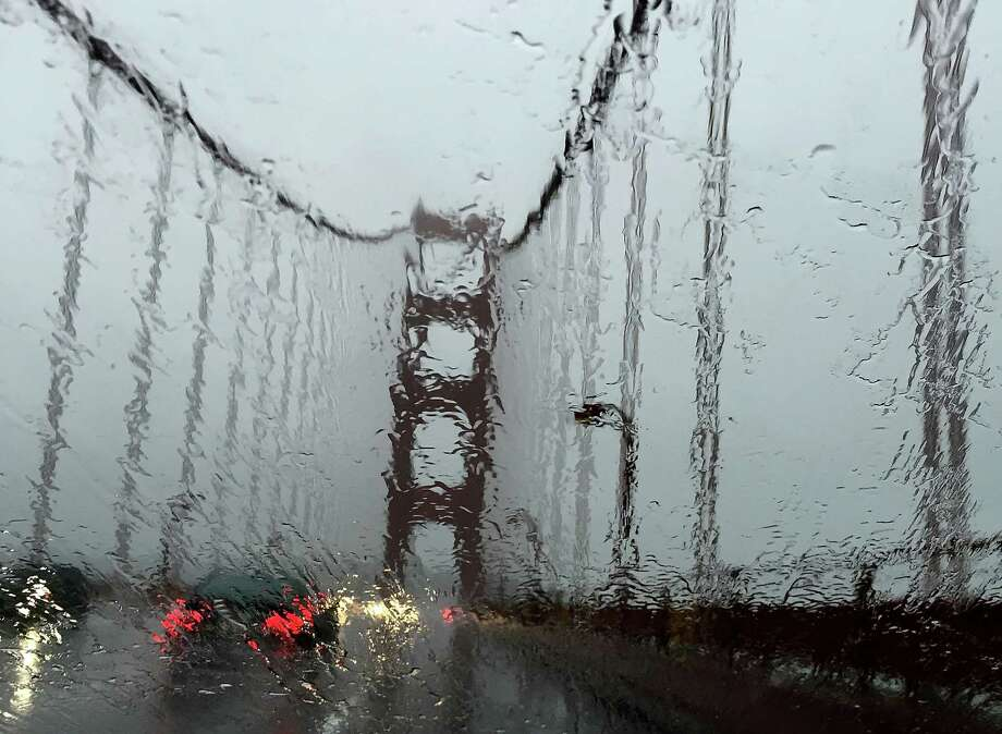 It's a rainy commute on the Golden Gate Bridge coming from Larkspur. Photo: Justin Sullivan / Getty Images / 2014 Getty Images