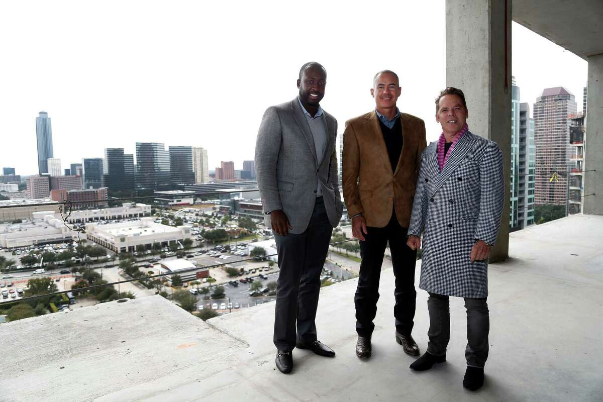 Acho Azuike, left, Roberto Contreras and Randall Davis expect the Galleria-area luxury tower Astoria to be completed next year. Foreigners seeking green cards have played a major role in financing it. ( Karen Warren / Houston Chronicle )