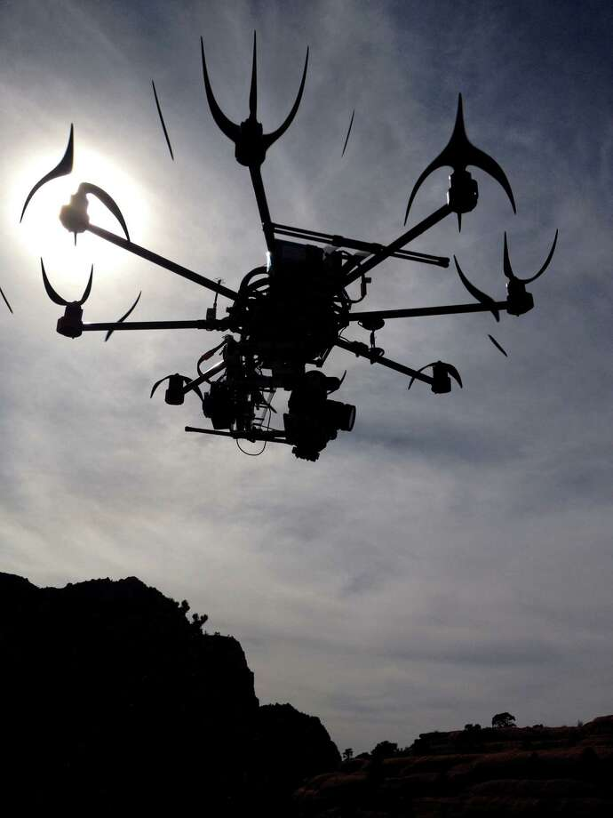 This image provided by Aerial MOB, LLC, shows their eight rotor Sky Jib Helicopter in San Diego, Calif., in August 2013. (AP Photo/Aerial MOB, LLC, Tony Carmean) Photo: Tony Carmean, HONS / Aerial MOB, LLC