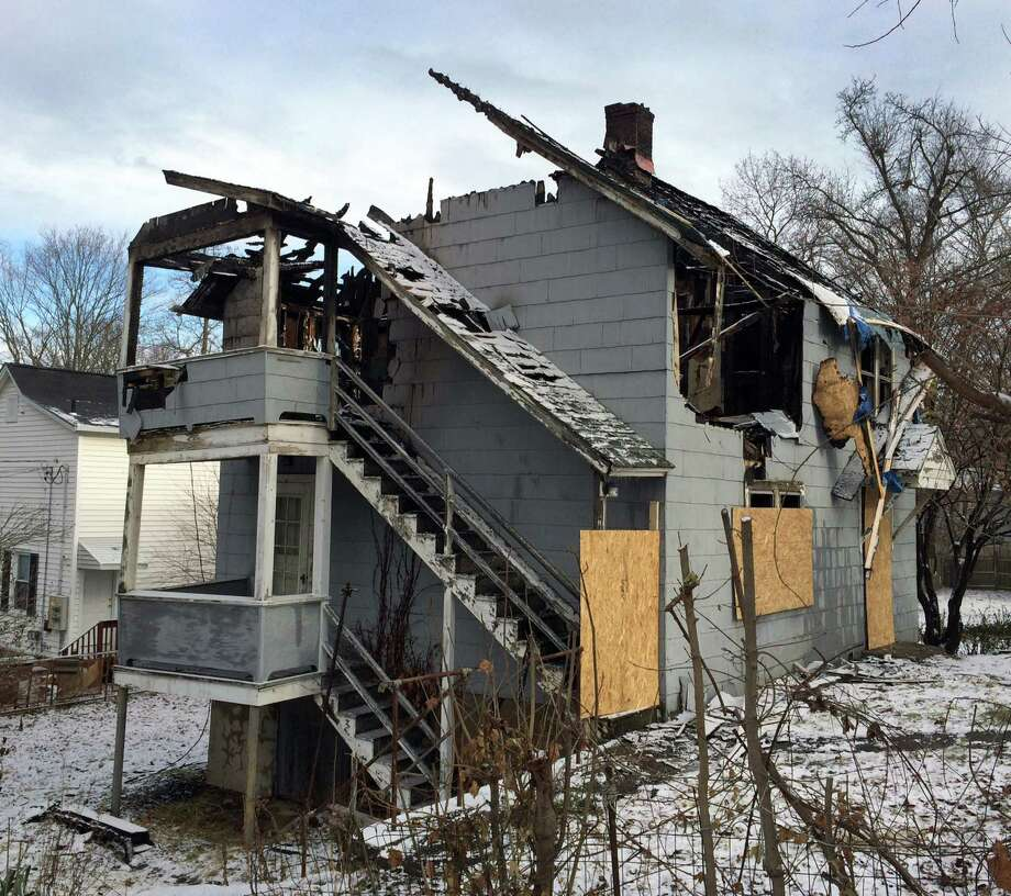 A two-alarm fire that tore through an abandoned West Wooster Street home in Dannbury, Conn., during the overnight hours Thursday remains under investigation. There were no injuries in the fire, which broke out at about 1 a.m. Thursday, Dec. 1, 2014. Photo: Carol Kaliff / The News-Times