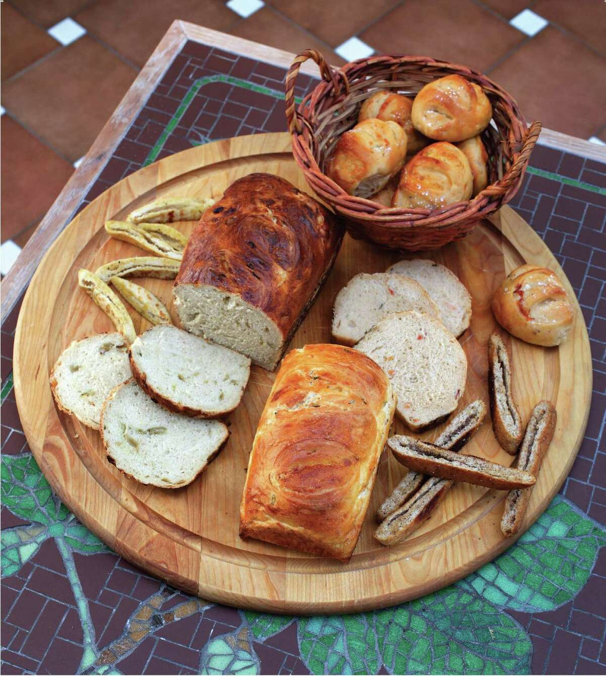 """Round out a Hanukkah meal with several kosher breads from the cookbook """"The Gourmet Jewish Cookbook"""" by Denise Phillips."""