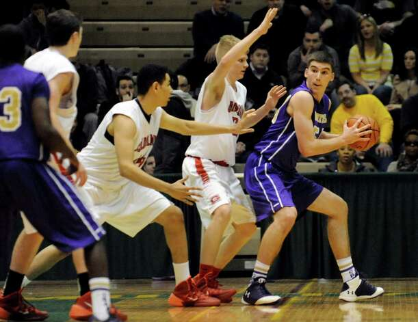 CBA's Greig Stire, right, looks for room during their Class AA basketball quarterfinal game against Guilderland on Saturday, Feb. 22, 2014, at Hudson Valley Community College in Troy, N.Y. (Cindy Schultz / Times Union) Photo: Cindy Schultz / 00025832A
