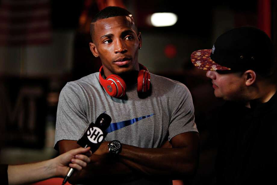 Erislandy Lara speaking with the media about his upcoming fight against Ishe Smith at ChampionFit Gym on Dec. 10, 2014. Photo: Spencer Selvidge / Spencer Selvidge / For The Express-News / © 2014 San Antonio Express-News