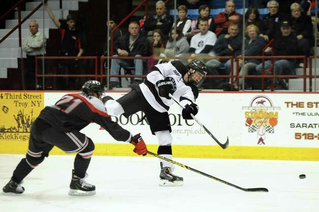 Union's Ryan Scarfo, right, shoots for the net as RPI's Mark McGowan defends during their hockey game on Friday, Oct. 31, 2014, at Rensselaer Polytechnic Institute in Troy, N.Y. (Cindy Schultz / Times Union) Photo: Cindy Schultz / 00029290A