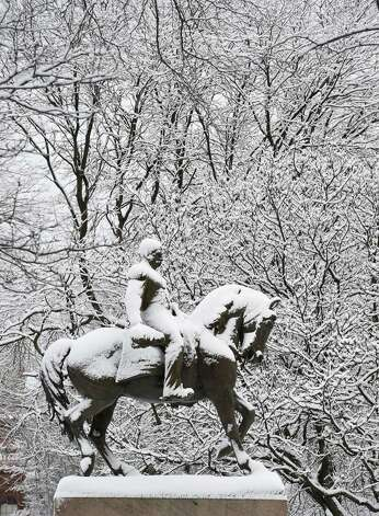 The stature of General Sheridan is snow covered and flanked by trees with snow attached to their limbs  Thursday morning in front of the State Capitol Dec. 11, 2014 in Albany, N.Y.    (Skip Dickstein/Times Union) Photo: SKIP DICKSTEIN