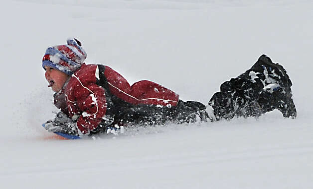 Logan Dittmer, 12, of Albany has fun sledding at Capital Hills at Albany on Thursday, Dec. 11, 2014 in Albany, N.Y. (Lori Van Buren / Times Union) Photo: Lori Van Buren