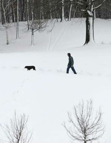 Craig Kellam of Albany walks his dog Coda at Capital Hills at Albany on Thursday, Dec. 11, 2014 in Albany, N.Y. (Lori Van Buren / Times Union) Photo: Lori Van Buren