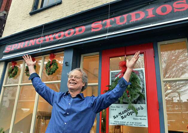Long-time Troy artist and furniture craftsman Jim Lewis announces the change of his shop's name from Icarus to Springwood Studios during a ceremony Thursday, Dec. 11, 2014, in Troy, N.Y.  (John Carl D'Annibale / Times Union) Photo: John Carl D'Annibale / 00029818A