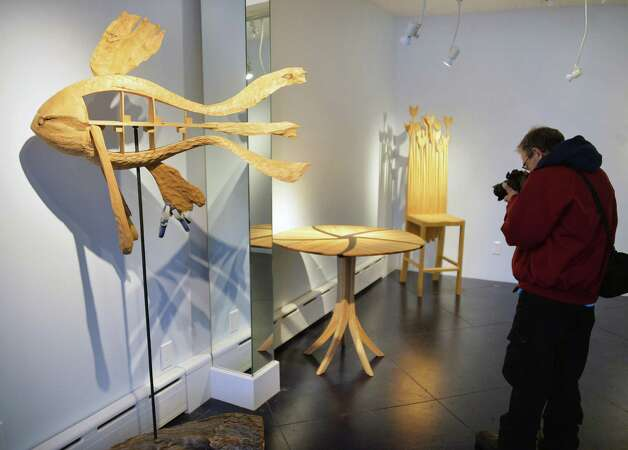 A photographer in the new showroom at Troy artist and furniture craftsman Jim Lewis's Springwood Studios Thursday Dec. 11, 2014, in Troy, NY.  (John Carl D'Annibale / Times Union) Photo: John Carl D'Annibale / 00029818A