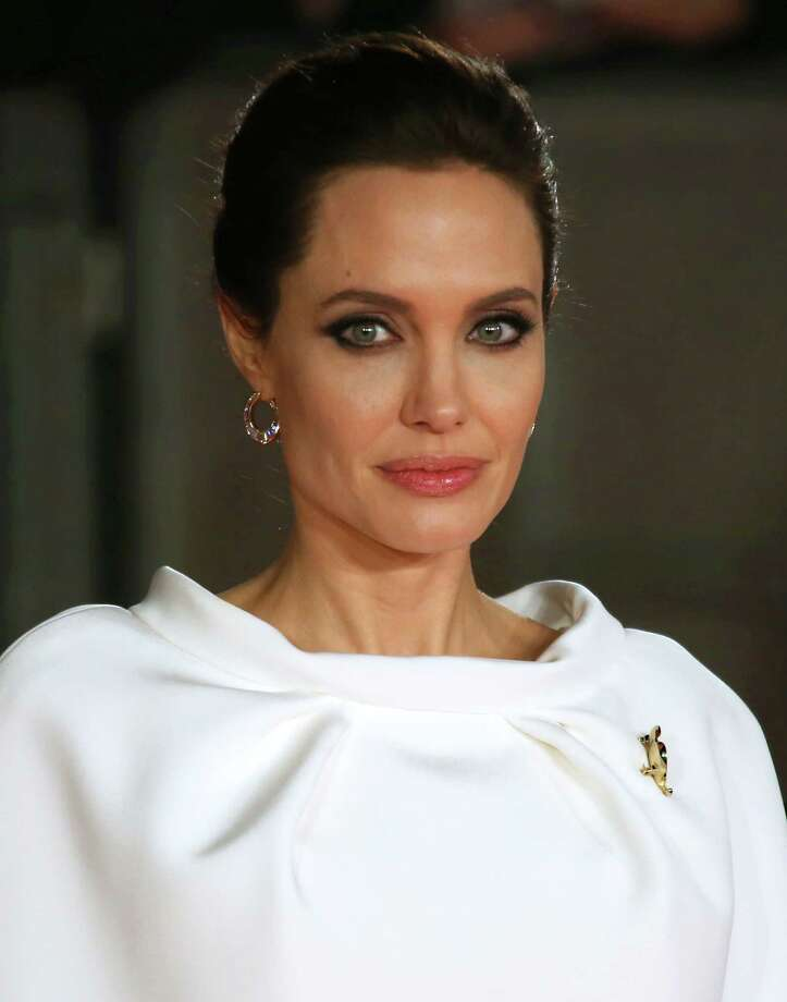 "FILE - In this Nov. 25, 2014 file photo, director Angelina Jolie poses for photographers upon arrival at the premiere of the film ""Unbroken"" in London. Scott Rudin, the high-powered producer at the center of the latest embarrassment stemming from the Sony hacking scandal, has apologized for remarks he made in leaked emails. In the series of private emails obtained by Gawker and Buzzfeed this week, Rudin, corresponding with Sony Pictures Entertainment co-chairman Amy Pascal, called ""Unbroken"" director Angelina Jolie a ""spoiled brat"" and made jokes about President Barack Obama's race and presumed taste in movies. (Photo by Joel Ryan/Invision/AP, File) Photo: Joel Ryan, INVL / Invision"