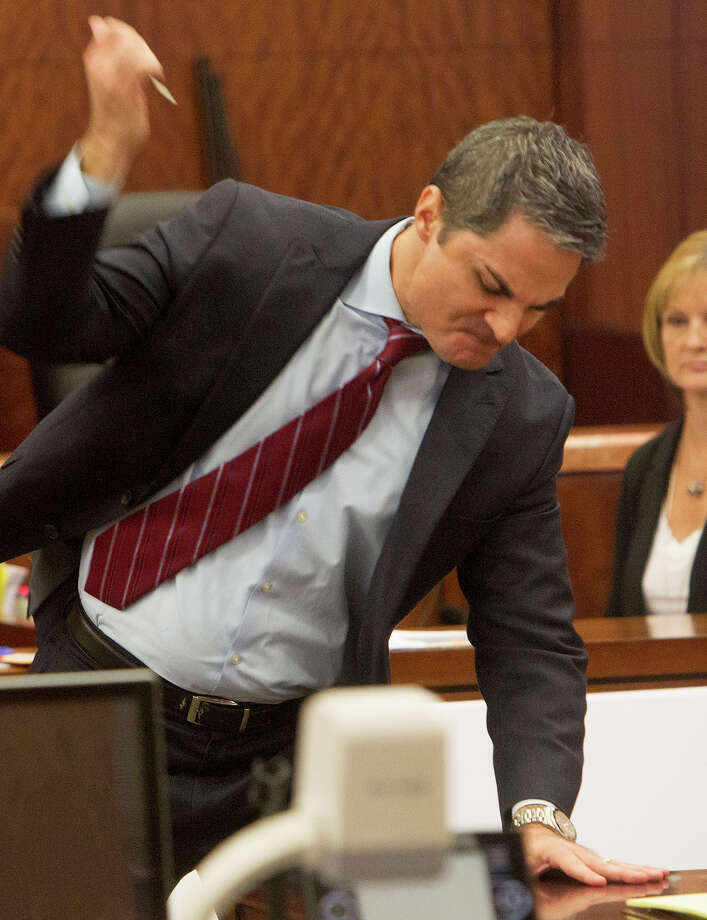 Prosecutor John Jordan uses a screwdriver to re-enact the slaying of Corriann Cervantes during closing arguments in the capital murder trial of Jose Reyes. Photo: Cody Duty, Staff / © 2014 Houston Chronicle