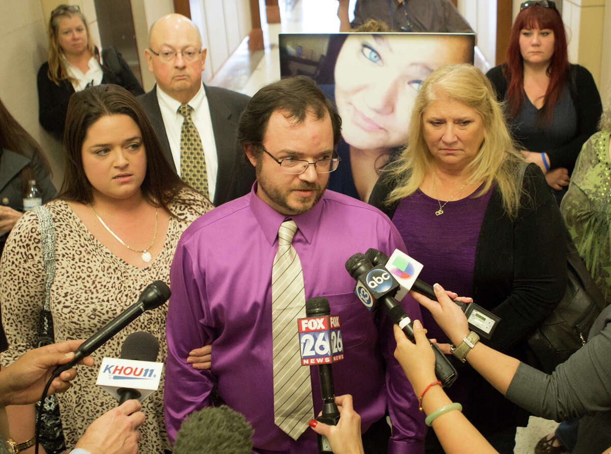 """With a poster-size photo of his daughter behind him, Cory Cervantes speaks to the media after her killer was sentenced to life in prison. Jose Reyes, 18, """"got what he deserved,"""" Cervantes said."""