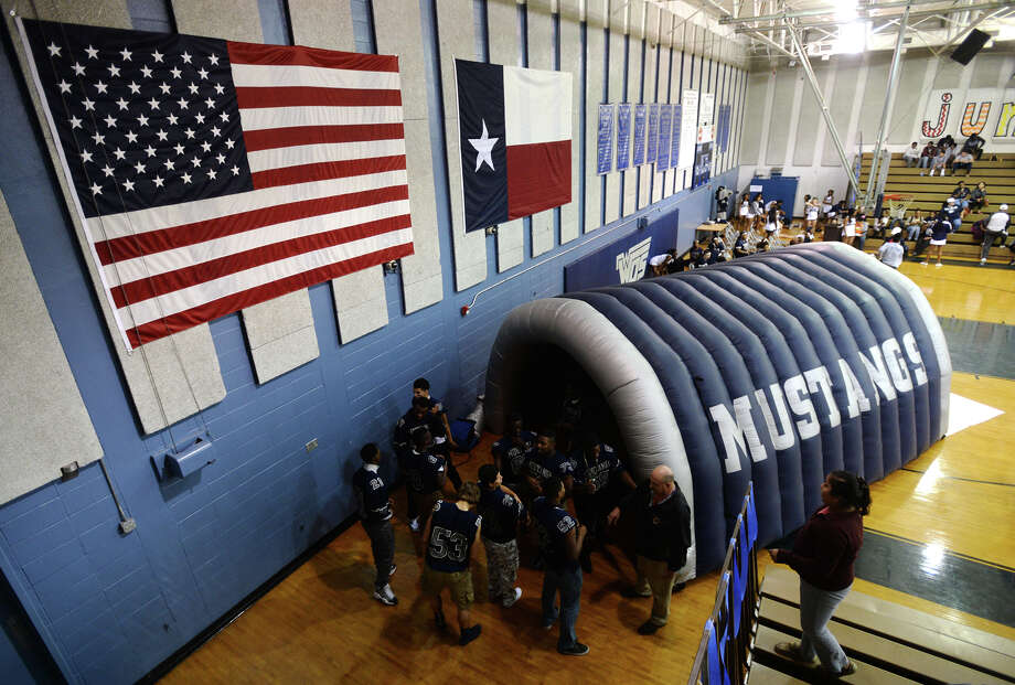 Mustang players start to gather around their inflatable tunnel before Thursday's rally. The West Orange-Stark Mustangs held a pep rally in their main gymnasium Thursday evening.  Photo taken Thursday 12/11/14 Jake Daniels/The Enterprise Photo: Jake Daniels / ©2014 The Beaumont Enterprise/Jake Daniels