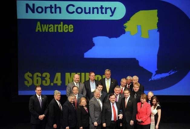 North County public officials pose with Gov. Andrew Cuomo after receiving a $63.4 million Regional Economic Development Award Thursday, Dec. 11, 2014, at the Egg in Albany, N.Y.  (Michael P. Farrell/Times Union) Photo: Michael P. Farrell / 00029800A