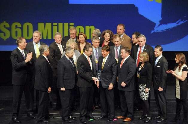 Capital Region public officials pose with Gov. Andrew Cuomo after receiving a $63.4 million Regional Economic Development Award Thursday, Dec. 11, 2014, at the Egg in Albany, N.Y.  (Michael P. Farrell/Times Union) Photo: Michael P. Farrell / 00029800A