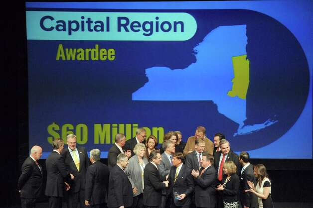 Capital Region public officials pose with Gov. Andrew Cuomo after receiving a $60 million Regional Economic Development Award Thursday, Dec. 11, 2014, at the Egg in Albany, N.Y.  (Michael P. Farrell/Times Union) Photo: Michael P. Farrell / 00029800A