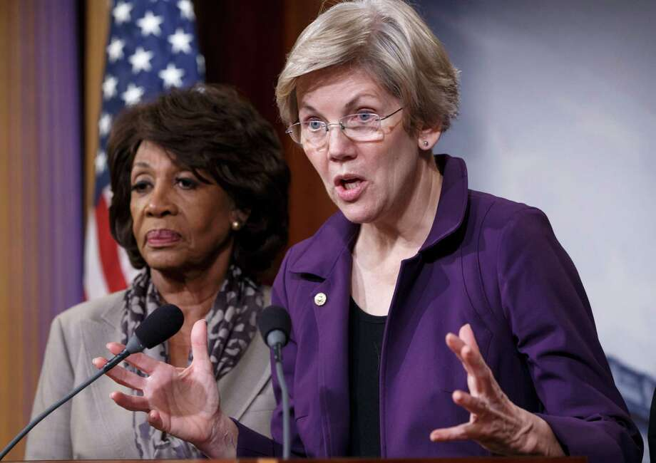 """Sen. Elizabeth Warren, with U.S. Rep. Maxine Waters, left, urged House Democrats to vote against the bill, asking, """"Who does Congress work for?"""" Photo: J. Scott Applewhite, STF / AP"""