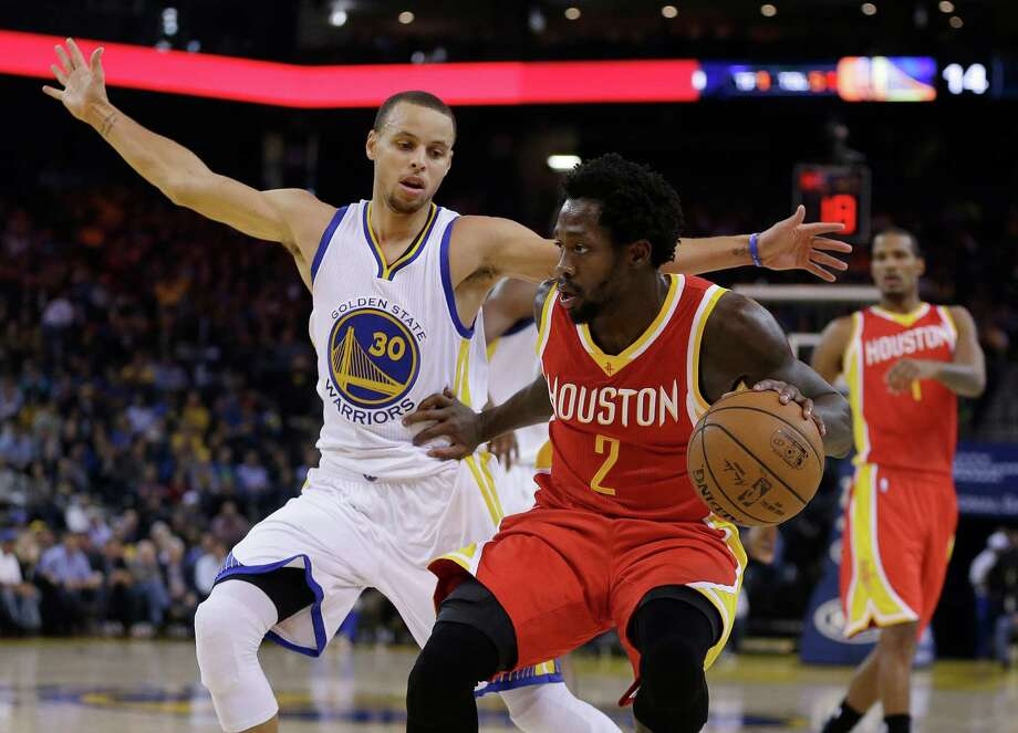 Houston Rockets' Patrick Beverley (2) drives the ball against Golden State Warriors' Stephen Curry, left, during the first half of an NBA basketball game Wednesday, Dec. 10, 2014, in Oakland, Calif. (AP Photo/Ben Margot) Photo: Ben Margot, STF / AP