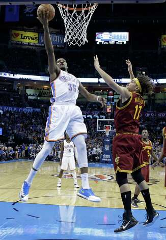 Oklahoma City Thunder forward Kevin Durant (35) shoots in front of Cleveland Cavaliers center Anderson Varejao (17) in the first quarter of an NBA basketball game in Oklahoma City, Thursday, Dec. 11, 2014. (AP Photo/Sue Ogrocki) ORG XMIT: OKSO108 Photo: Sue Ogrocki / AP