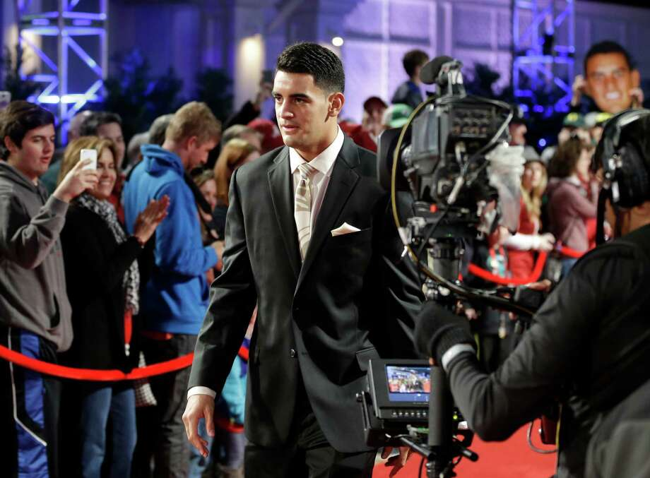Oregon quarterback Marcus Mariota arrives at the College Football Awards presentation on Thursday night and left with three of college football's top awards. Photo: John Raoux, STF / AP