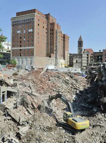 Crews continue to work on the site where the former Wellington Annex stood on Monday, Aug. 25, 2014, in Albany, N.Y.  The building was imploded on Saturday to make way for the convention center.  (Paul Buckowski / Times Union) Photo: Paul Buckowski / 00028325A