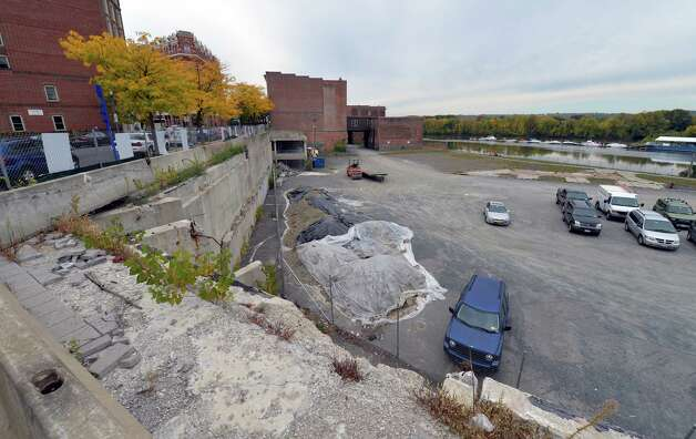 The site of the former Troy City Hall which was torn down is now a large parking area Monday morning Sept. 29, 2014 in Troy, N.Y.   with Developers have plans to put a water-front attraction in this space.  (Skip Dickstein/Times Union) Photo: SKIP DICKSTEIN / 10028806A