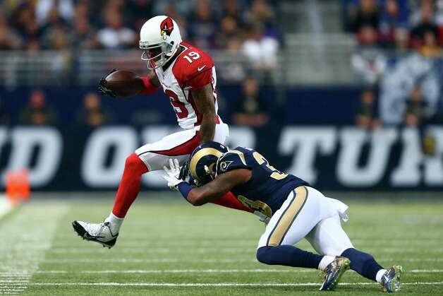 ST LOUIS, MO - DECEMBER 11:    Ted Ginn #19 of the Arizona Cardinals gets pushed out of bounds by E.J. Gaines #33 of the St. Louis Rams in the second quarter during their game at Edward Jones Dome on December 11, 2014 in St Louis, Missouri.  (Photo by Dilip Vishwanat/Getty Images) ORG XMIT: 507874553 Photo: Dilip Vishwanat / 2014 Getty Images