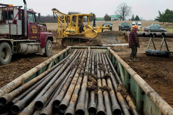 Drill pipe is ready to be used at a Knox Energy oil drilling site in Knox County, Ohio. Low crude prices are giving consumers a break at the pump, but they're also expected to slow U.S. oil production.