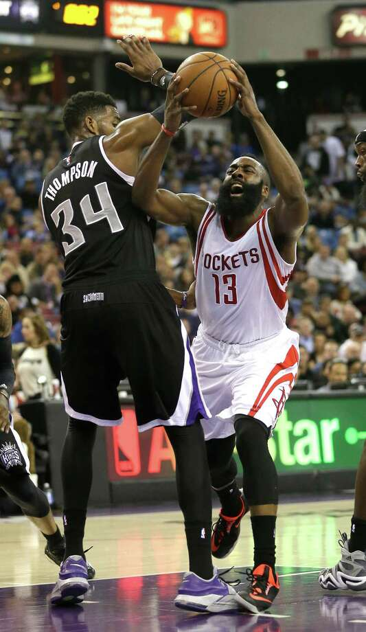 James Harden, drawing a foul from the Kings' Jason Thompson, sent the game to overtime with a 3-pointer, then dominated the extra session. Photo: Rich Pedroncelli, STF / AP