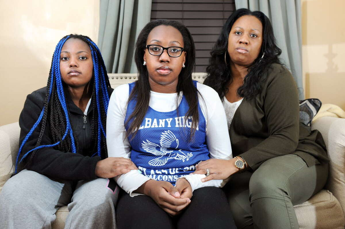 Kori Dobbs, 17, center, with her sister Camille Dobbs, 14, left, and their mother Selina Dobbs on Thursday, Nov. 20, 2014, at their home in Albany, N.Y. Kori was recently elected Senior Class President and has faced ugly, racist harassment on Twitter and social media. (Cindy Schultz / Times Union)
