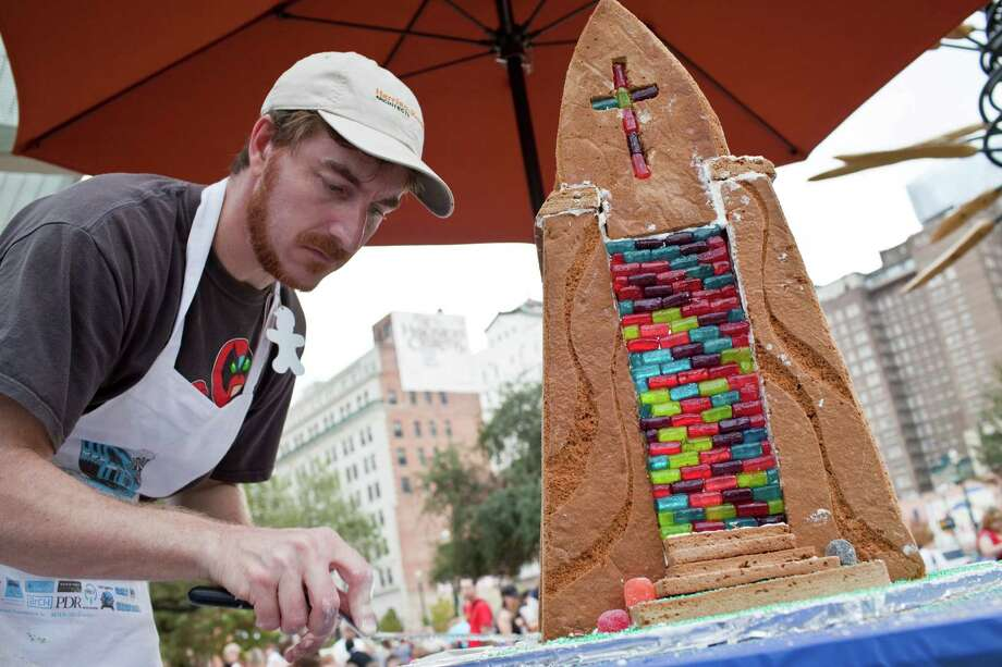 "Jeromy Murphy , works on a gingerbread cathedral ""based on my memories of a cathedral,"" at the 2010 Gingerbread House Build-off Photo: Eric Kayne, Freelance / Freelance"