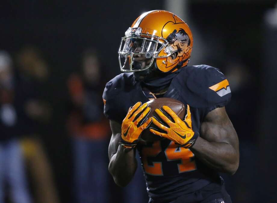 Oklahoma State's Tyreek Hill is pictured in the second quarter of an NCAA college football game against Texas in Stillwater, Okla., Saturday, Nov. 15, 2014. Texas won 28-7. (AP Photo/Sue Ogrocki) Photo: Sue Ogrocki, Associated Press