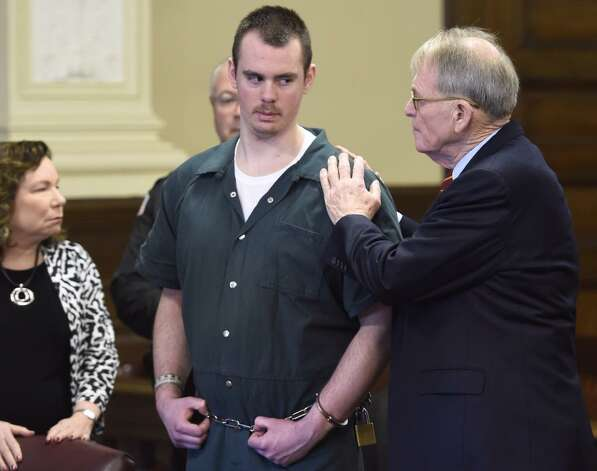 Anthony Repp, center, pleaded guilty on Friday, Dec. 12, 2014, in Rensselaer County Court to murdering his stepfather and mother. (Skip Dickstein/Times Union)