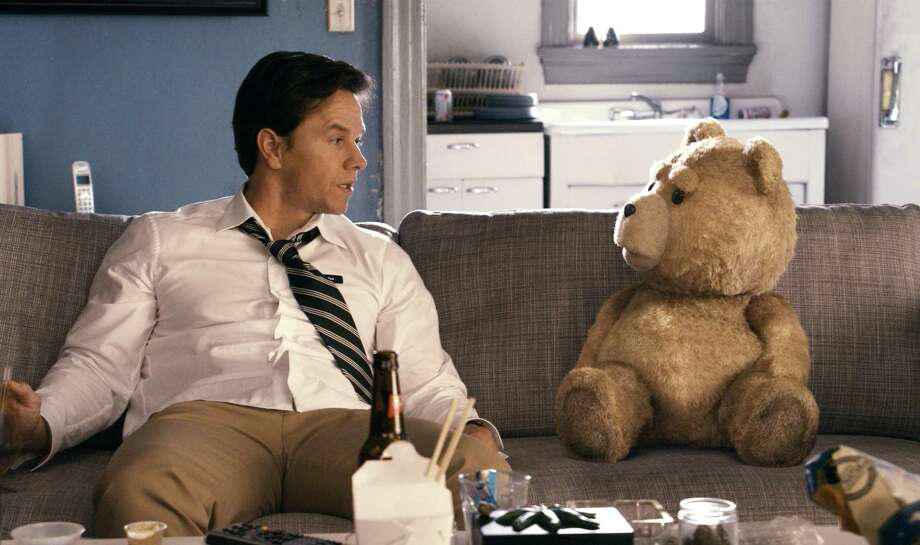 """This film image released by Universal Pictures shows Mark Wahlberg, left with the character Ted, voiced by Seth MacFarlane in a scene from """"Ted."""" The film's sequel is released June 26. (AP Photo/Universal Pictures) Photo: AP, File Photo / Copyright: © 2012 Universal Studios. ALL RIGHTS RESERVED."""